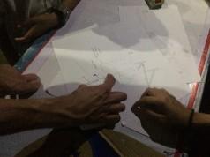 Discussing ideas in Tongkol kampung